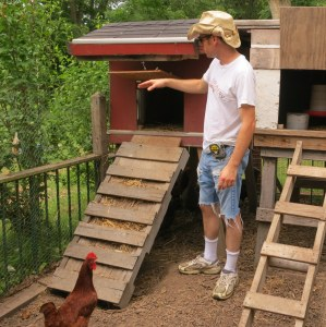 Josh discusses his coop set-up and chicken care with visitors on a recent tour.
